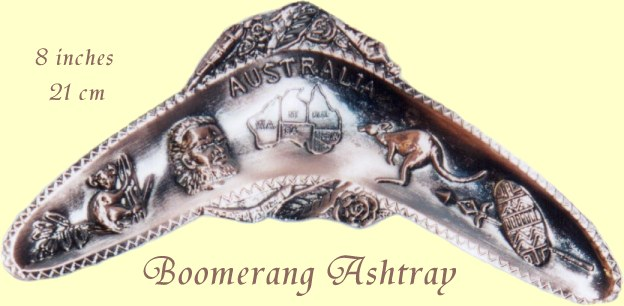 Boomerang shaped brass ashtray with Australian motifs