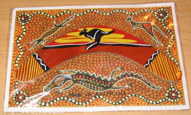 Small souvenir boomerang on Aboriginal dot art card