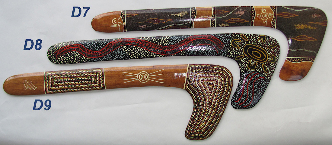Hook boomerangs decorated by Aboriginal artists