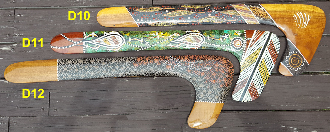 Hook boomerangs painted by aboriginal artist with elements of fine dot art and crosshatch - Aboriginal art painting techniques.